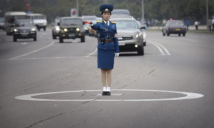 A North Korean traffic police officer mans her position while directing traffic on Thursday, Oct. 8, 2015, in Pyongyang, North Korea. (AP Photo/Wong Maye-E)
