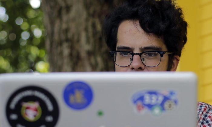 Michael Madden works on his website, on Sept. 10, 2015, in Austin. Madden a largely self-taught analyst of North Korea with an encyclopedic knowledge of the government elite. (AP Photo/Eric Gay)