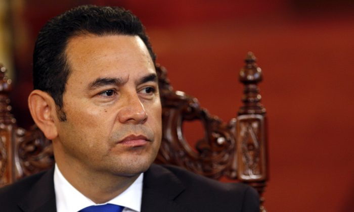 Comedian Jimmy Morales, who's running for president with the National Front of Convergence party, attends a meeting at the National Palace with his rival to sign an agreement to respect governmental institutions ahead of the election in Guatemala City, Thursday, Oct. 22, 2015. (AP Photo/Luis Soto)