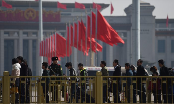 Visitors line up to enter Tiananmen Square, next to the Great Hall of the People, the venue for upcoming meetings of China's legislature in Beijing on March 2, 2015. (Greg Baker/AFP/Getty Images)