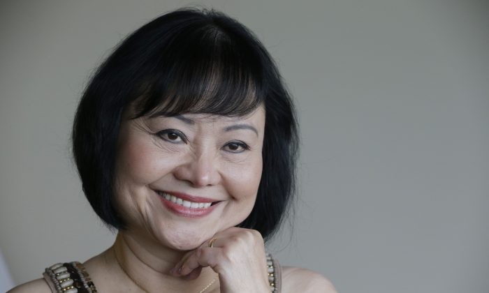 Kim Phuc poses for a photo at a hotel in Miami on Sept. 25, 2015. Phuc arrived from her home in Canada to undergo a series of laser treatments to reduce the scars and pain she has endured for 40 years following an attack on her village during the Vietnam war. (AP Photo/Nick Ut)