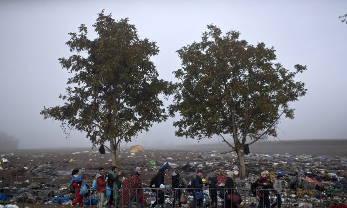 A group of people walks towards Serbia's border with Croatia in Berkasovo, Serbia, on Oct. 24, 2015. Thousands of migrants and refugees are still crossing from Serbia into Croatia and continuing their journey towards Western Europe. (AP Photo/Marko Drobnjakovic)