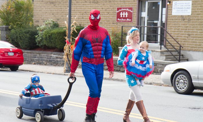 Port Jervis Halloween Parade participants walking up Pike Street in Port Jervis on Oct. 25, 2015. (Holly Kellum/Epoch Times)
