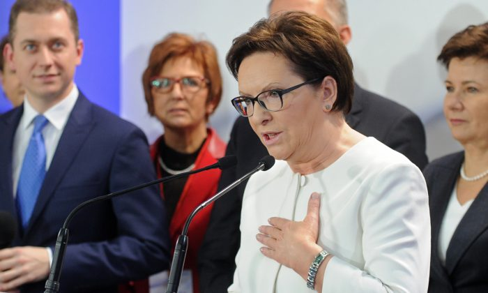 Polish Prime Minister Ewa Kopacz addresses supporters after the first exit polls were announced following general elections in Warsaw, Poland, Sunday, Oct. 25, 2015. (AP Photo/Alik Keplicz)