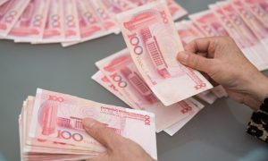 China's Offshore Yuan Spread Heightens Expectations of Further Currency Devaluation