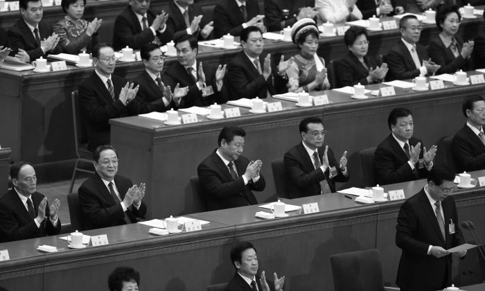 Chinese Communist Party leaders attend a session of the National People's Congress on March 5, 2015. (Greg Baker/AFP/Getty Images)