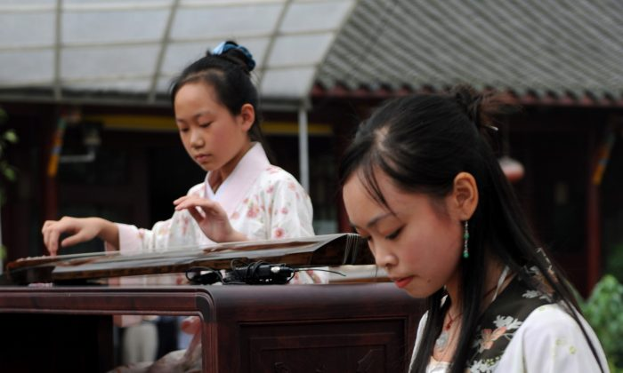 Young Chinese women play the classical, and complicated, guqin, a relative of the zither family. (China Photos/Getty Images)