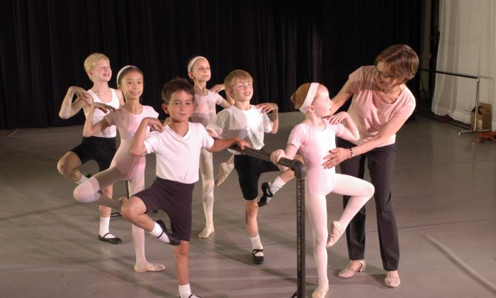 Diana Byer, founder and artistic director of the New York Theatre Ballet, correcting children's dance positions.