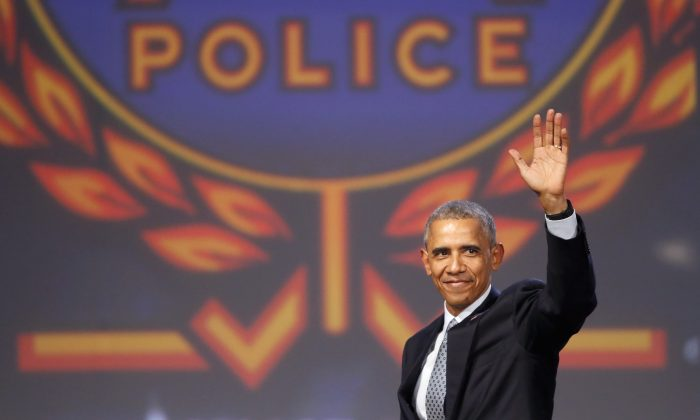 President Barack Obama waves after speaking at the 122nd International Association of Chiefs of Police Annual Conference, Tuesday, Oct. 27, 2015, in Chicago.  (AP Photo/Charles Rex Arbogast)