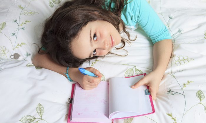 Encourage your children's appreciation of writing. (Louis-Paul St-Onge/iStock)