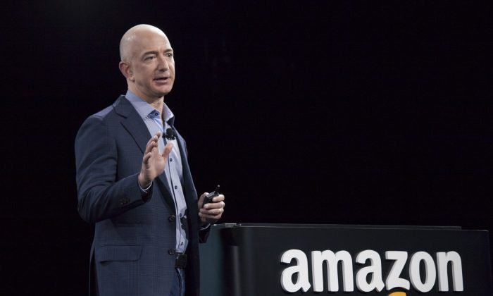 Amazon.com founder and CEO Jeff Bezos presents the company's first smartphone, the Fire Phone, on June 18, 2014, in Seattle, Washington.(David Ryder/Getty Images)