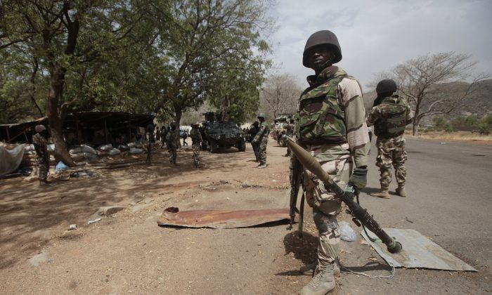 Nigerian soldiers man a checkpoint in Gwoza, Nigeria, a town newly liberated from Boko Haram, on April 8, 2015. (AP Photo/Lekan Oyekanmi)