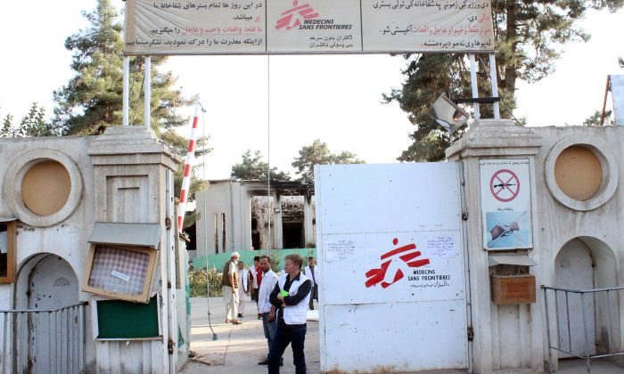 In this Oct. 15, 2015 file photo, Christopher Stokes, the general director of medical charity Doctors Without Borders, which is also known by its French abbreviation MSF, stands at the gate of the organization's hospital, after it was hit by a U.S. airstrike in Kunduz, Afghanistan. (Najim Rahim via AP)