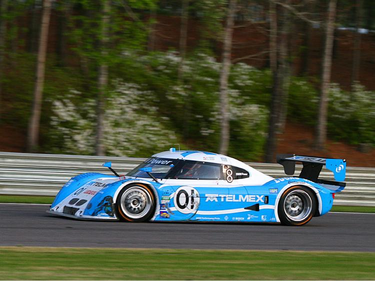 The #01 car shows the scars of battle as Scott Pruett wheels it home for the win. (James Fish/The Epoch Times)