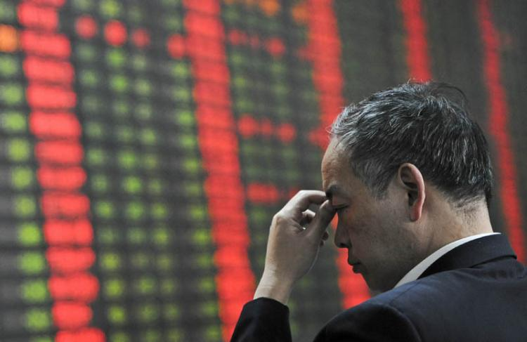 Keeping a cool head when faced with red numbers- besides China's small investors, the regime had gambled massively. Does an economic crisis loom on the horizon now? (Mark Ralston/AFP/Getty Images)
