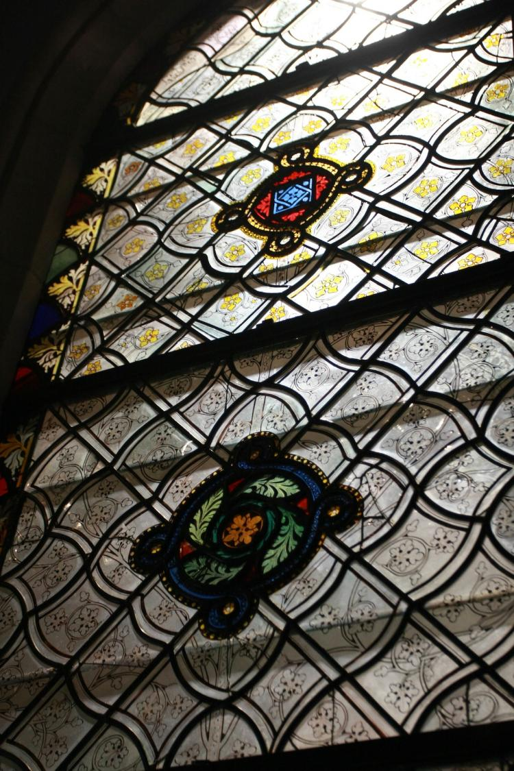 A MEDIEVAL FLOWER: This stained-glass window, displaying a botanical theme, came to New York from Normandy, France. It was made in 14th century for the choir of the abbey church of Saint Ouen.  (Tara MacIsaac/The Epoch Times)