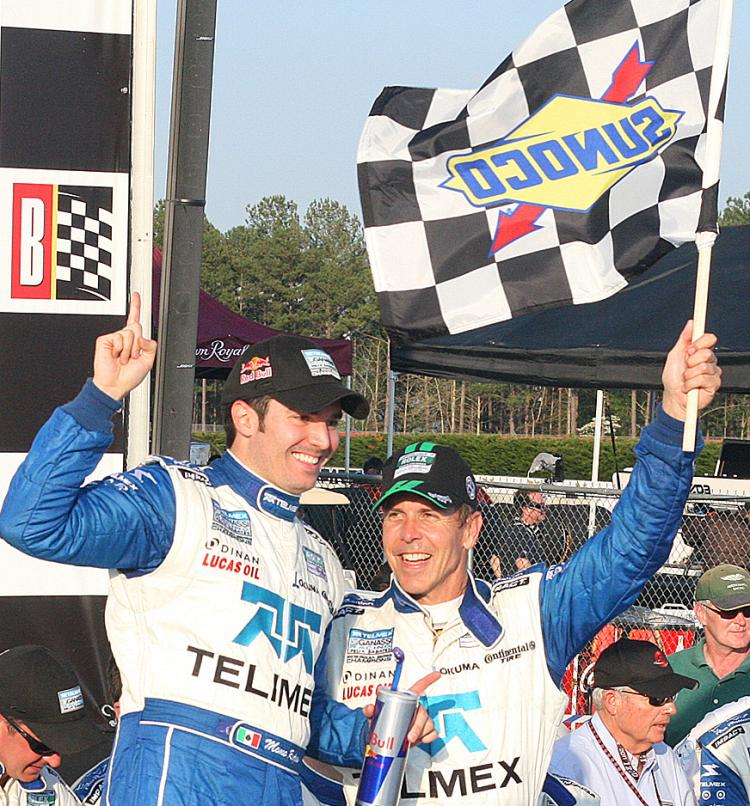 SIX STRAIGHT: Memo Rojas (L) and Scott Pruett celebrate one more in a long string of victories. (James Fish/The Epoch Times)