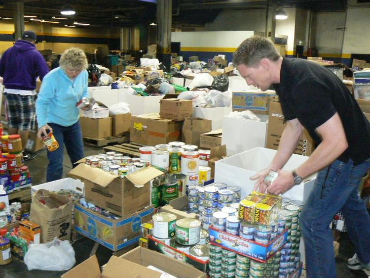 Volunteers sort and pack goods at the warehouse in Tacoma on Friday. (Burke Long)