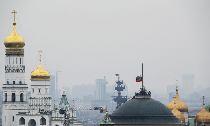 The Russian national flag is flown at half-mast on top of the Senate Building in Kremlin in Moscow, Russia, on Nov. 1, 2015. (AP Photo/Pavel Golovkin)