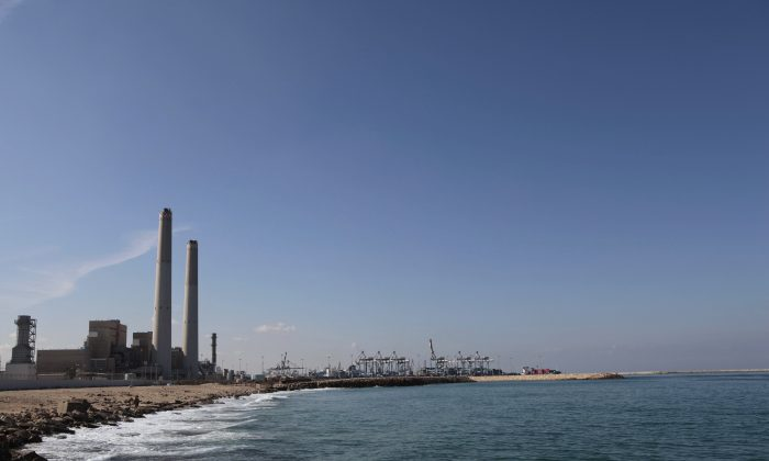 A general view of the Eshkol power station, the first in Israel to produce electricity from natural gas, in the coastal city of Ashdod, southern Israel, on Oct. 7, 2015. When natural gas was discovered a few years ago off the shores of resource-poor Israel, it was heralded as nothing short of a miracle, but an emerging deal with developers has been plagued by criticism, with opponents accusing Prime Minister Benjamin Netanyahu of caving to a monopoly. (AP Photo/Tsafrir Abayov)