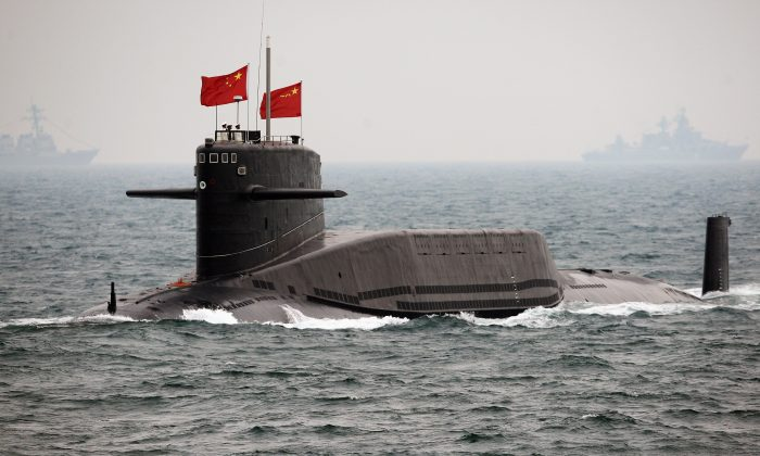 A People's Liberation Army Navy submarine on April 23, 2009, off Qingdao, in Shandong Province. (Guang Niu/AFP/Getty Images)
