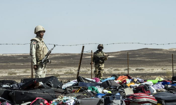 Egyptian army soldiers next to the luggage and belongings of passengers of the A321 Russian airliner piled up at the site of the crash in Wadi al-Zolomat, a mountainous area in Egypt's Sinai Peninsula, on Nov. 1, 2015. (Khaled Desouki/AFP/Getty Images)