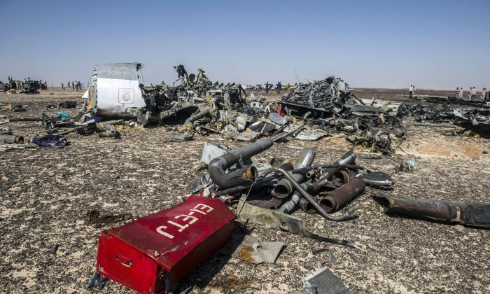 Debris belonging to the A321 Russian airliner are seen at the site of the crash in Wadi al-Zolomat, Egypt's Sinai Peninsula, on Nov. 1, 2015. The incident has triggered conspiracy theories. (Khaled Desouki/AFP/Getty Images)
