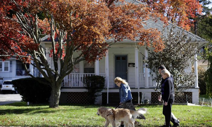 Audrey Stone (L) walks with her guide dog, Figo, after they were reunited or the first time in months after an accident that injured both of them in Brewster, N.Y., Monday, Oct. 26, 2015. (AP Photo/Seth Wenig)