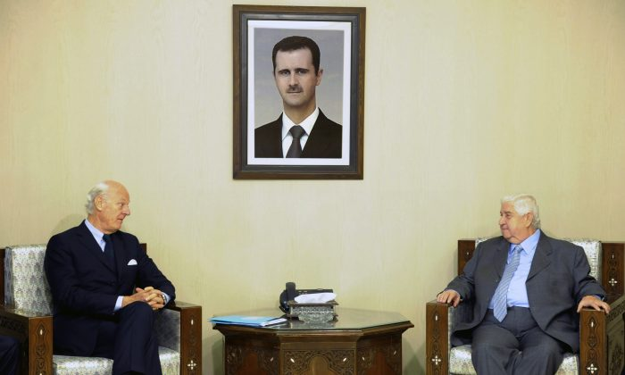 """Syria's Foreign Minister Walid al-Moallem (R) meets with U.N. Special Envoy for Syria Staffan de Mistura in Damascus, Syria, Sunday, Nov. 1, 2015. Al-Moallem said """"important"""" points were made during international talks aimed at reviving the peace process but that negotiators failed to convince his government's foes to curb their support for """"terrorism."""" (SANA via AP)"""