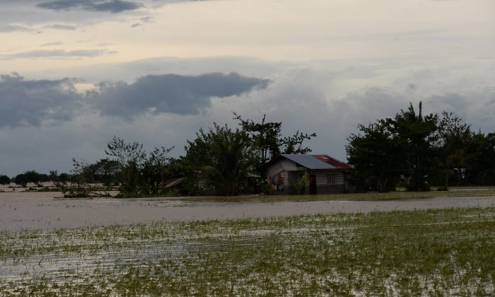 This photo taken on October 20, 2015 shows submerged houses and rice fields due to heavy rains brought about by typhoon Koppu with floods as high as three metres, wiping out vast swathes of farmlands, sinking deeper poor farmers into a quicksand of crushing debt in the rice-growing central region.       (TED ALJIBE/AFP/Getty Images)
