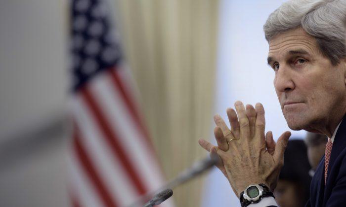 U.S. Secretary of State John Kerry looks on while Uzbek President Islam Karimov makes an opening statement before a meeting at the Palace of Forums on the President's Residential Compound in Samarkand, Uzbekistan Sunday, Nov. 1, 2015. (Brendan Smialowski/AP)