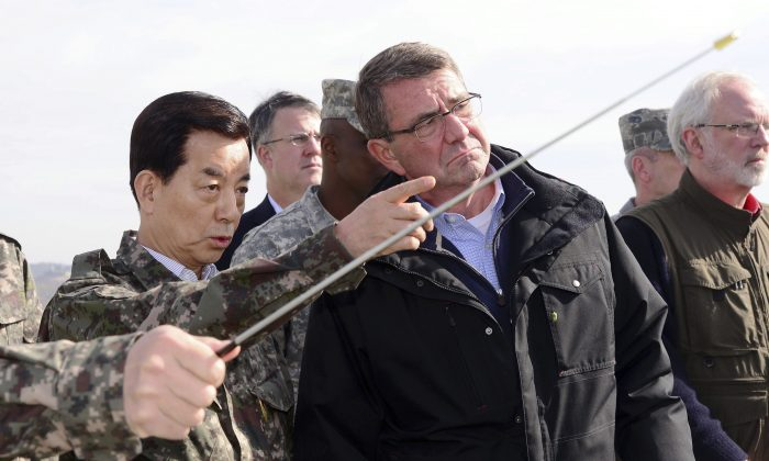 U.S. Defense Secretary Ash Carter (C) looks towards North Korea as South Korean Defense Minister Han Min Koo (L) briefs at an observation post near the border village of Panmunjom, which has separated the two Koreas since the Korean War, in Paju, South Korea, Sunday, Nov. 1, 2015. (AP)
