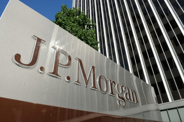 A JPMorgan Chase sign is seen outside the office tower housing the financial services firm's Los Angeles, Calif., offices, on Aug. 8, 2013. (Robyn Beck/AFP/Getty Images)