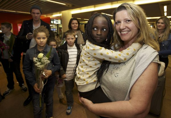 Belgian Laurence Senechal (R) arrives at Brussels National Airport in Zaventem from Kinshasa on Aug. 31, 2014, where she was greeted by her adopted daughter, Imany. Senechal was sentenced in Kinshasa in the Democratic Republic of Congo to six months of imprisonment for the 'wrongful removal' of the child, a 6 year old girl she had adopted. (Nicolas Maeterlink/AFP/Getty Images)