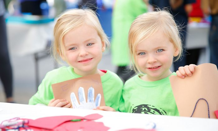 Mia and Ella Allan make crafts for seniors and local childrens hospitals while generationOn and Hasbro Distribute Holiday Gifts to Local LA Families at El Centro del Pueblo on December 6, 2014 in Los Angeles, California. (Joe Scarnici/Getty Images for generationOn and Hasbro)