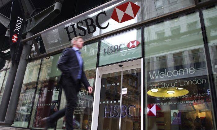 A businessmen walks past the entrance to a HSBC bank branch in London on June 9, 2015. (JUSTIN TALLIS/AFP/Getty Images)