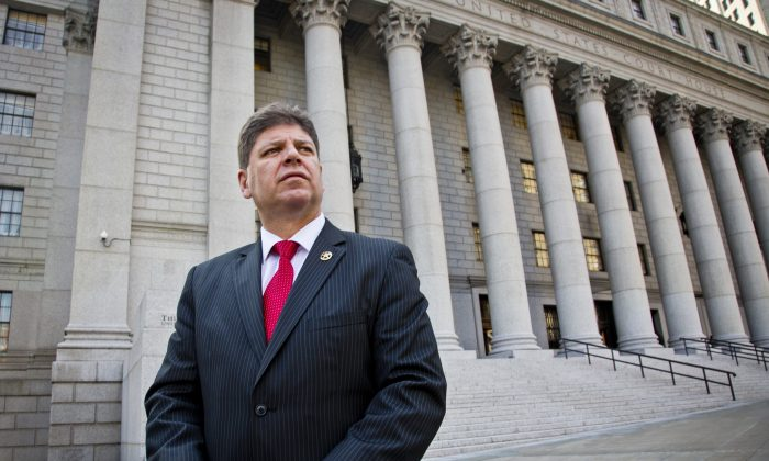 U.S. Marshall Director Michael Greco pose outside near courts the agency is responsible for, Thursday, Oct. 8, 2015, in New York. (AP Photo/Bebeto Matthews)