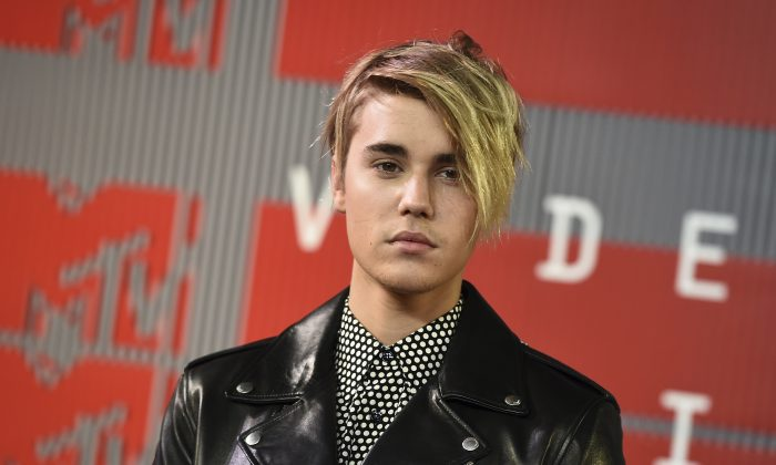 Justin Bieber arrives at the MTV Video Music Awards in Los Angeles on Aug. 30, 2015. Bieber received a favorable probation report in a misdemeanor vandalism case on Monday, Nov. 2, 2015, and a Los Angeles judge ruled that the pop singer will no longer be on supervised probation in the case, which was filed after he damaged a former neighbor's house with eggs. (Jordan Strauss/Invision/AP)