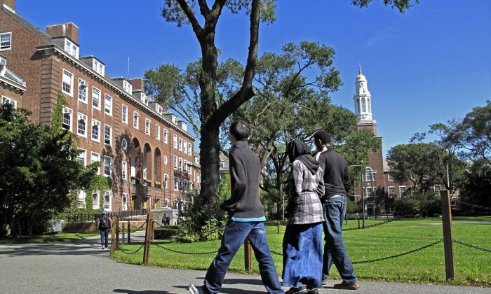 People walk on the campus of Brooklyn College in the Brooklyn, New York, on Oct. 7, 2011. (AP Photo/Bebeto Matthews)