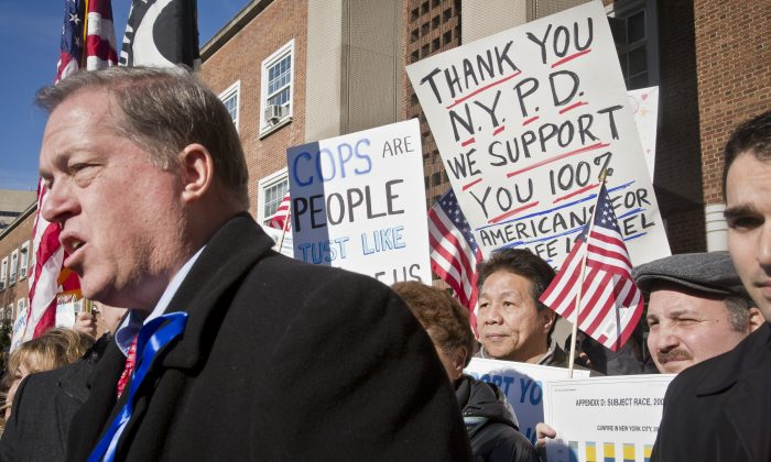 Retired NYPD Captain Joe Concannon speaks during a pro-police rally and press conference outside Queens Borough Hall, Tuesday, Jan. 13, 2015, in New York. Concannon is now the Republican candidate for city councilman from Queens. (AP Photo/Bebeto Matthews)