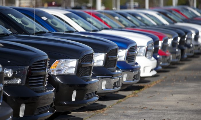 Ram pickup trucks are on display on the lot at Landmark Dodge Chrysler Jeep RAM in Morrow, Ga., on Jan. 5, 2015. Fiat Chrysler sold almost 41,000 Rams in October 2015, the company reported Tuesday, Nov. 3, 2015, a 3 percent gain over a year ago for FCA's top-selling vehicle. (AP Photo/John Bazemore)