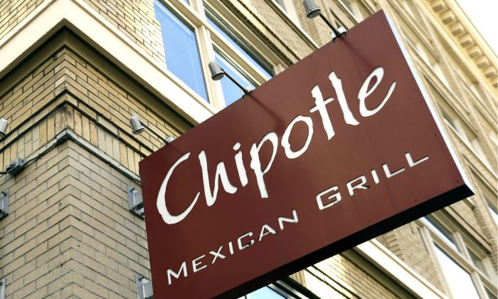 Signage hangs from a closed Chipotle restaurant in Portland, Ore., Monday, Nov. 2, 2015. (AP Photo/Don Ryan)