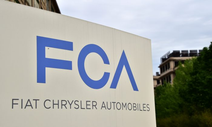 A picture shows the Fiat Chrysler Automobiles (FCA) logo at the entrance of the headquarters, on April 19, 2015 in Turin. (GIUSEPPE CACACE/AFP/Getty Images)