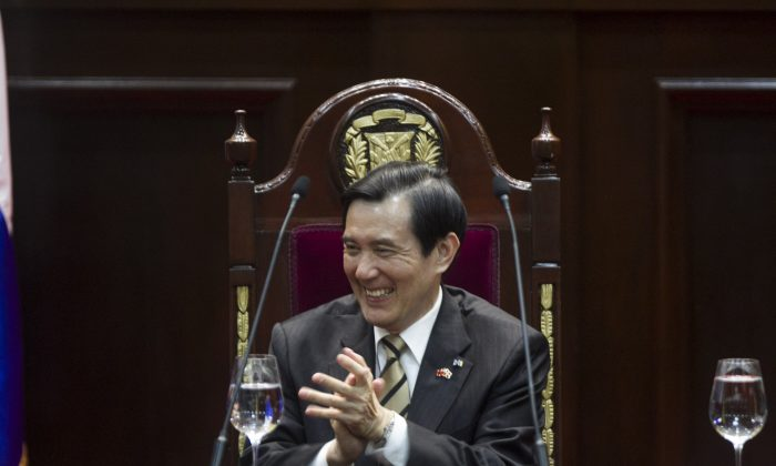 Taiwan President Ma Ying-jeou applauds at the Congress in Santo Domingo, on July 13, 2015. (ERIKA SANTELICES/AFP/Getty Images)