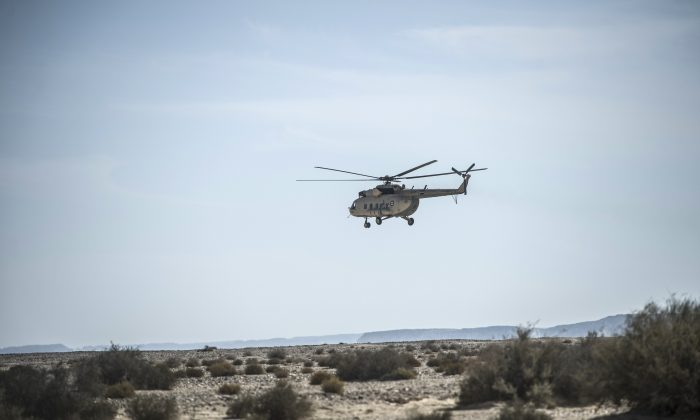 An Egyptian army helicopter flies over the crash site of an A321 Russian airliner in Wadi al-Zolomat, a mountainous area in Egypt's Sinai Peninsula, on Nov. 1, 2015. (Khaled Desouki/AFP/Getty Images)