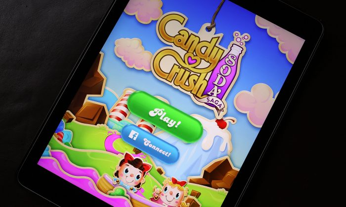 A Candy Crush game is seen on an iPad in Miami, Fla., on Nov. 3, 2015. It was announced today that game maker Activision Blizzard has paid $5.9 billion to purchase King, the parent company of games like Candy Crush Saga and Bubble Witch Saga. (Joe Raedle/Getty Images)