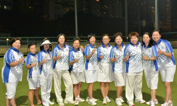 THE RECORD BREAKER!! A jubilant Hong Kong Football Club women team celebrates their ninth straight champion at the Premier League Division 1. (Mike Worth)