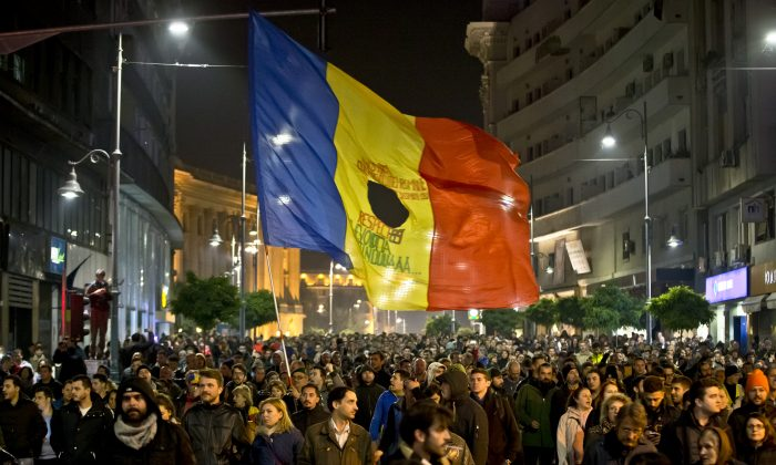 Romanians fill the Calea Victoriei, a main avenue of the Romanian capital, during a large protest in Bucharest, Romania, Tuesday, Nov. 3, 2015. (AP Photo/Vadim Ghirda)
