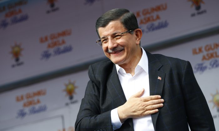 Turkish Prime Minister Ahmet Davutoglu salutes supporters during a rally of his Justice and Development Party (AKP), in Ankara, Turkey, on Oct. 31, 2015. (Umit Bektas/AP)