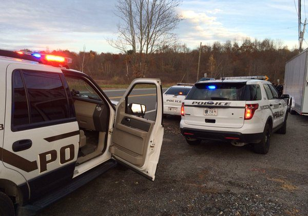 Police stop a car for what appears to be drunk driving. It turns out that while there were several open Coronas in the car, it was the passenger who was drinking, not the driver. (Holly Kellum/The Epoch Times)